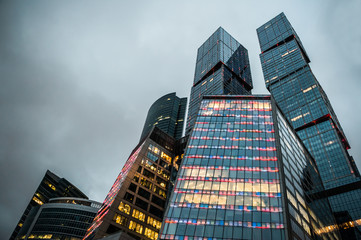 Modern skyscrapers of the business center at evening lights