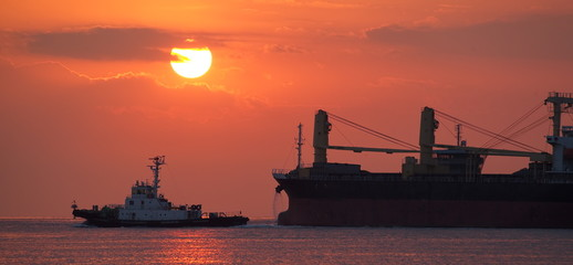 Cargo ship and Beautiful sunset at the ocean