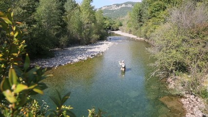Upper view of fly fisherman in river
