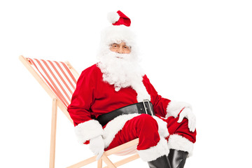 Santa Claus seated in a sun lounger