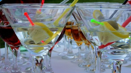 cocktail with lemon and olives, poured into beautiful glasses
