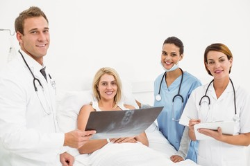 Doctors explaining x-ray to patient