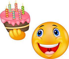 Smiley emoticon holding birthday cake