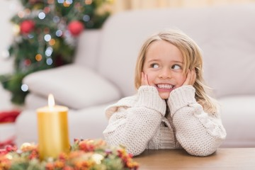 Cute little girl smiling at christmas