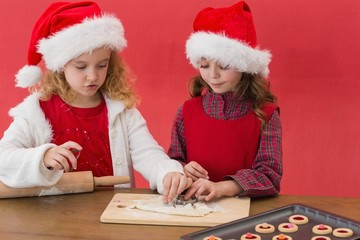 Festive little girls making christmas cookies
