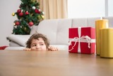 Fototapety Festive little boy looking at gifts