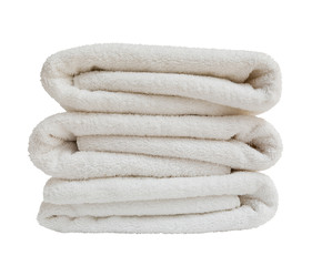 Stack of white plush  towels isolated on white background