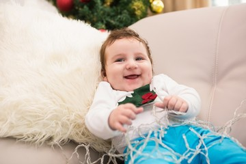 Cute baby boy on the couch at christmas