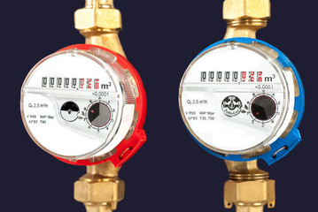 Water meters, sanitary equipment on dark background.