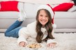 canvas print picture - Festive little girl eating cookies
