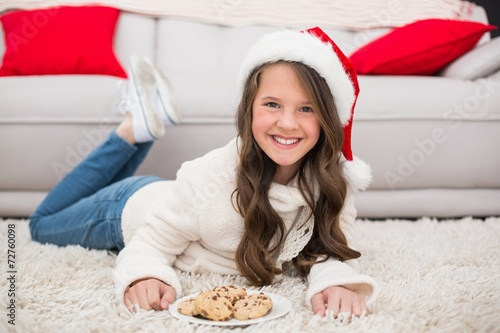 canvas print picture Festive little girl eating cookies