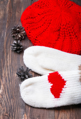 Knitted mittens with red hearts and knitted hat