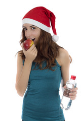 Fit Christmas woman on diet eating apple