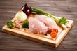 Raw chicken breasts on cutting board