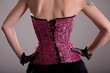 Rear view of elegant woman wearing purple corset