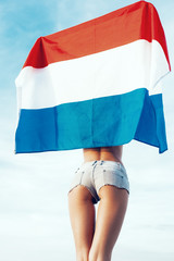 Beautiful young pretty woman with national Dutch flag