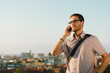 Professional casual man on cellphone job call - 72763093
