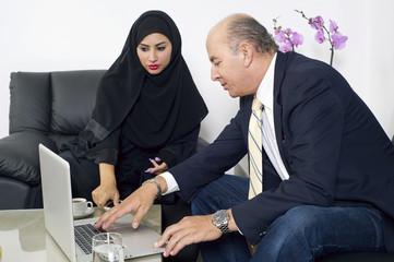 Senior Businessman meeting with Arabian businesswoman