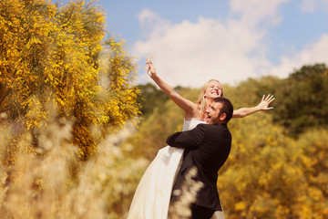 Bride and Groom having fun in the fields