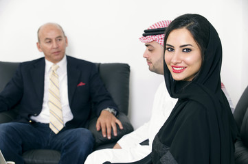 Arabian Businesspeople meeting with foreigner