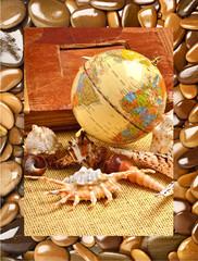 Globe, seashells, old album