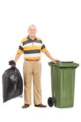 Senior man holding a bag of trash