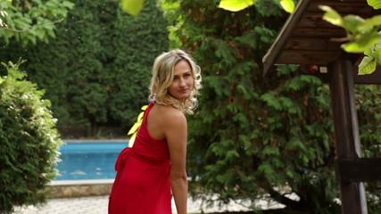 girl in red dress posing in the park