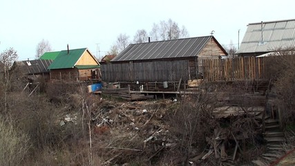 Wooden log houses of russian village.