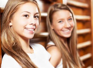 Two cute teenage girls on gymnastic training