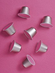 Coffee capsules on pink background