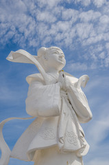 Statue of Chinese Goddess with blue sky background