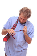 Man trying to bind a tie