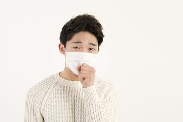 Asian man wearing a face mask with coughing