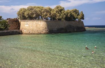Bathers in sea at Chania, Crete, Greece