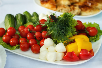 Cut vegetables greens and cheese