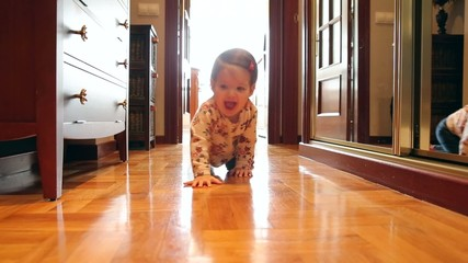Happy baby girl at floor home