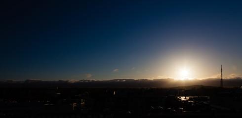 Sunset under the city