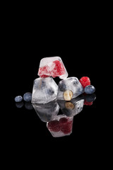 Berries frozen in ice cubes.