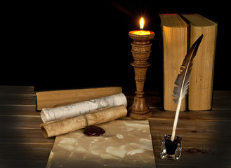 old books with a candle