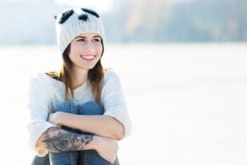 Teenage girl with wool cap
