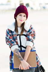 Teenage girl with wool cap