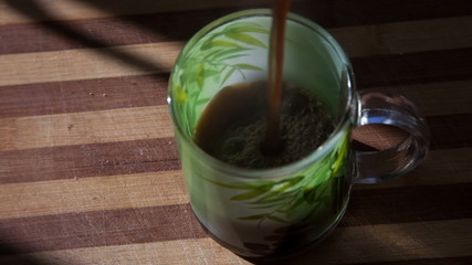 adding coffee in the milk