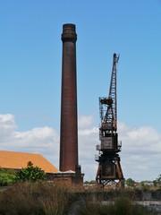 Historic harbor crane and a chimney on Cockatoo Island