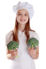 The girl in a suit of the cook with broccoli