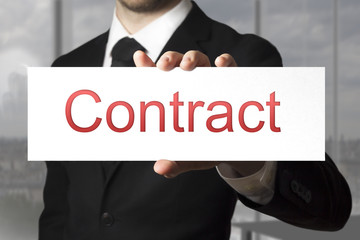 businessman showing sign contract