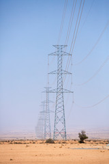 Electrical towers across the desert near Tata, Morocco