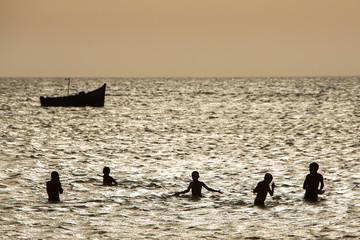 Young group of people having fun in ocean