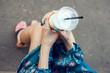 Woman with glasses drinking milkshake