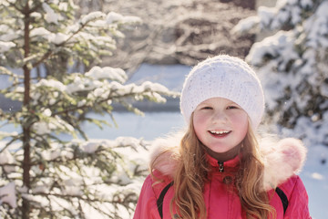 smile girl in winter forest