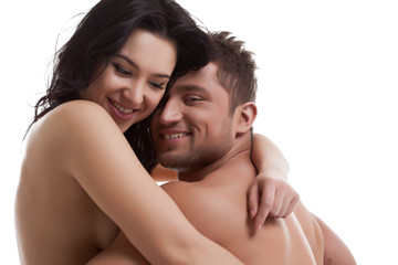 Smiling nude lovers hugging at camera
